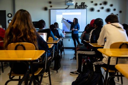 Abbie Weipert teaches a personal finance class Thursday, Dec. 5, 2019 at West High School in Iowa City, Iowa.