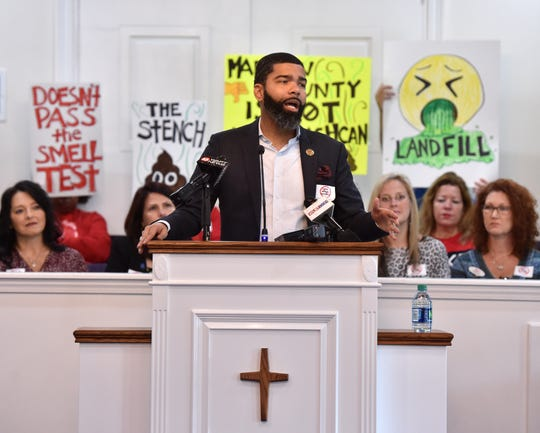 Jackson Mayor Chokwe Antar Lumumba speaks from the pulpit of Rocky Hill Baptist Church in Ridgeland, Miss. on Thursday, Dec. 5, 2019 during a meeting of citizens organized against the proposed development of a third landfill in Madison County.