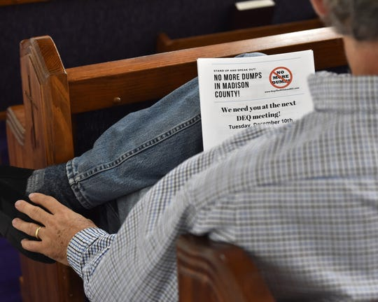 A man holds material protesting the potential development of a third landfill in Madison County, Mississippi during a meeting of concerned citizens held at Rocky Hill Baptist Church in Ridgeland, Miss. on Thursday, Dec. 5, 2019.