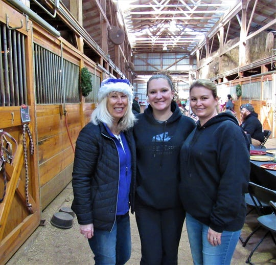 Volunteer Andy Walker, adoption specialist Ashley Ford and volunteer coordinator Kelly Crenshaw welcomed guests during Breakfast in the Barn at Horse Haven on Dec. 1.