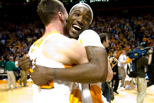 Tennessee's Wayne Chism celebrates with teammate Steven Pearl after Tennessee defeated Kansas 76-68 at Thompson-Boling Arena, Sunday, Jan 10, 2010.