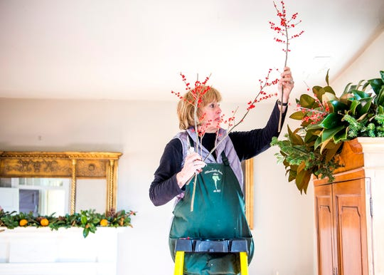 Georganne Guarino with the Knoxville Garden Club puts the finishing touches on Christmas decorations inside Blount Mansion on Thursday, December 5, 2019. The Knoxville Garden Club spent Thursday morning decorating Blount Mansion and the Craighead-Jackson House.