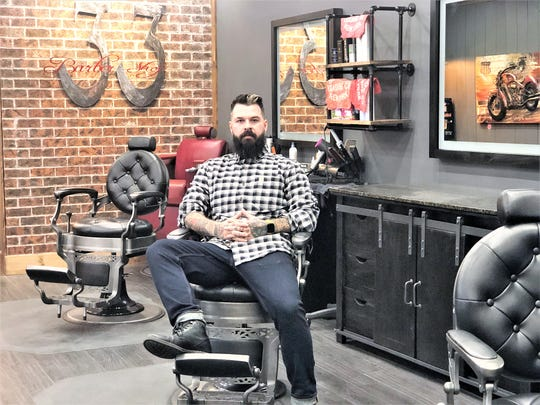 Brian Morgan manages the new 33 Barbershop at 4010 Fountain Valley Drive in Halls.