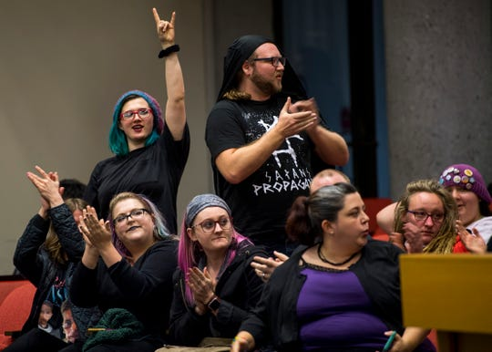 Opponents of the Bible Release Program show their support of one speaker's message during the public forum portion of the Knox County School Board Meeting held at the City-Council Building in downtown Knoxville on Wednesday, December 4, 2019.