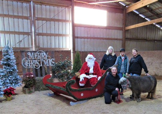 "The staff at Horse Haven wished all a Merry Christmas at ""Breakfast in the Barn with Twinkie and Santa"" on Dec. 1.  The four women run the organization with the help of numerous volunteers.  Santa and Twinkie are part-time jobholders. 2019"
