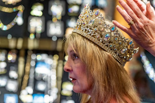 Jamie Morgan, queen of The Krewe of Diamondhead being fitted with custom crown. Dynasty Collection is one of the few Mardi Gras crown makers left in the country. Wednesday, Dec. 4, 2019.