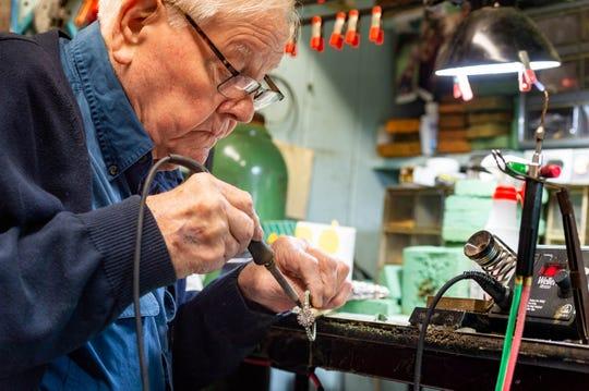 Craftsman Jim Rhinewalt soldering custome sceptor in workshop. Dynasty Collection is one of the few Mardi Gras crown makers left in the country. Wednesday, Dec. 4, 2019.