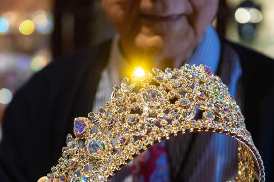 Jewels in a custom made crown sparkle under the lights. Dynasty Collection is one of the few Mardi Gras crown makers left in the country. Wednesday, Dec. 4, 2019.