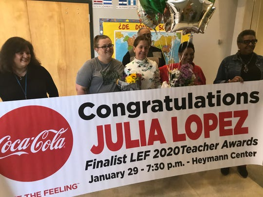 Charles Burke Elementary teacher Julia Lopez, center, stands with school staff when she was selected as a finalist for the Lafayette Education Foundation's Teacher Awards on Dec. 5, 2019.