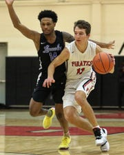 Junior Dylan Reason (11) returns for his third season as Pinckney's point guard.