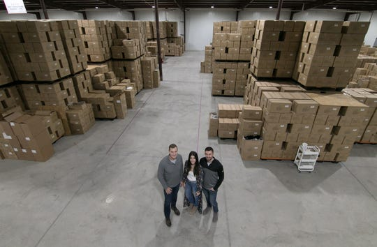 From left, Jerry McLean, daughter Keia McLean and Keia's fiancé, Jimmy Banish, shown Thursday, Dec. 5, 2019, run The Bear Factory in Green Oak Township.