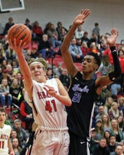 Pinckney's Luke Lovell (41) showed he could have an impact playing on varsity as a sophomore, even going against competition like Emoni Bates (21) of Ypsilanti Lincoln.
