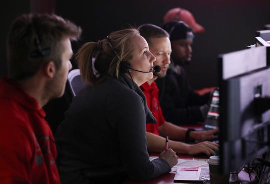 An ESPN associate producer (center) helps out with two graphics members at Louisville's ACC Network broadcast center during the Louisville-UT Chattanooga women's basketball game. Nov. 21, 2019