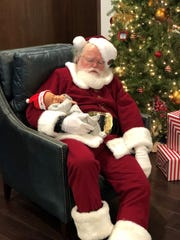 Samuel Turner is pictured at 15 days old with Santa Claus at a Christmas brunch at Valhalla Golf Club on Dec. 1.