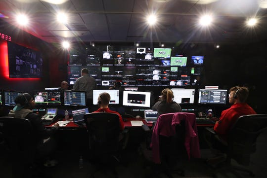 A TV crew at Louisville's ACC Network broadcast center prepares for the start of the Louisville-UT Chattanooga women's basketball game. Nov. 21, 2019
