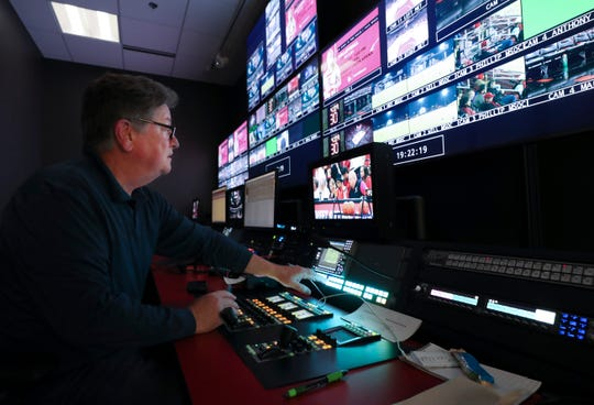 Video technician Greg Kapfhammer helps out with a broadcast of a University of Louisville men's soccer match at the school's ACC Network broadcast center. Nov. 21, 2019