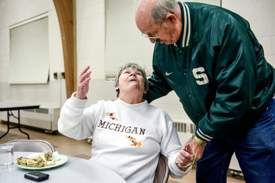 Jacqueline LaForge, left, is greeted by Ed Kaiser during the Open Table free community meal on Wednesday, Dec. 4, 2019, at the Williamston United Methodist Church. Kaiser's wife Sue is one of the founders of the event. The meal is served every Wednesday from 5 to 6 p.m.