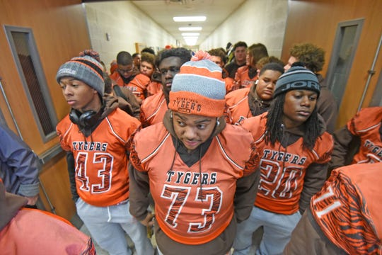 The Tyger football team ready themselves for a parade through the school, accepting well-wishes from their classmates.