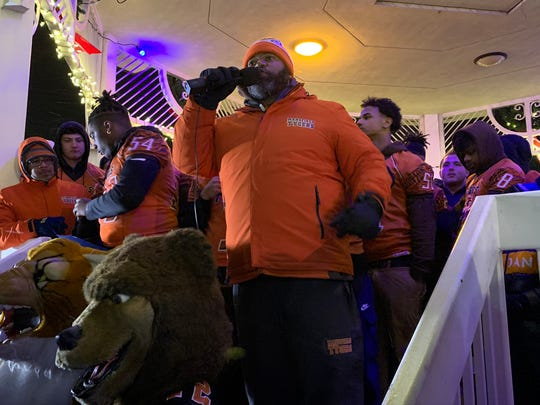 Mansfield Senior football coach Chioke Bradley pumps up the crowd during a pep rally to celebrate his Tygers and the Lucas Cubs before they played for 2019 state championships. The community united as Senior High and Lucas became the first two Richland County teams to reach the state finals.
