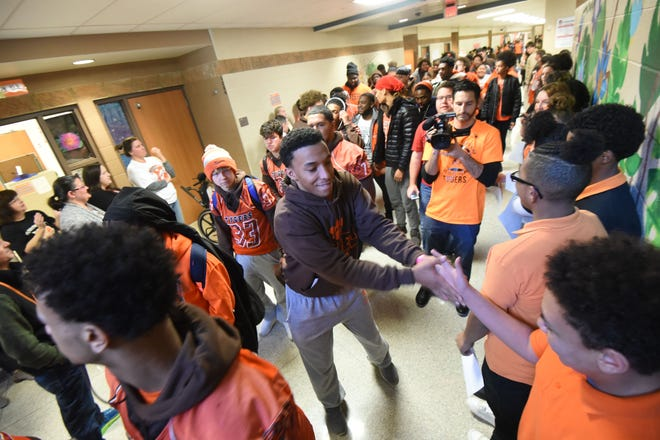 Mansfield Tygers football players paraded through the halls and accepted good luck wishes from their classmates Thursday afternoon.