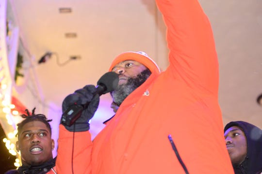 Chioke Bradley, head coach of Mansfield Senior's football team, extends his hand to the crowd before a pep rally leading up to the Tygers' appearance in the state championship finals