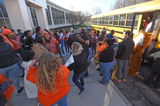 The Tyger football team board the bus to the state championship in Canton.