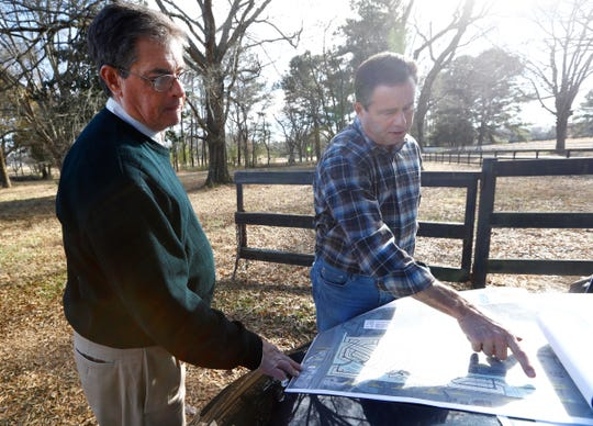 John Porter, right, a developer with Quinn Ridge Partners, and Mike Davis of the Reaves Firm point to their plans to build on a plot of land that Porter has been attempting to develop along Quinn Road in Collierville. Pushback from local residents about maintaining a rural landscape has so far held back his plans for housing units on the property that has been owned by his family for generations.