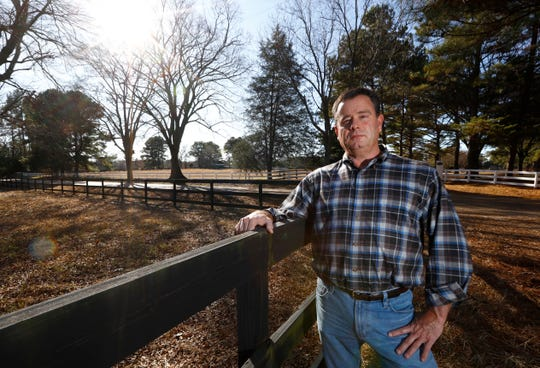 John Porter, a developer with Quinn Ridge Partners, poses for a portrait at the entrance to a plot of land he has been attempting to develop along Quinn Road in Collierville. Pushback from local residents about maintaining a rural landscape has so far held back his plans for housing units on the property that has been owned by his family for generations.