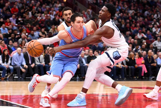 Bulls guard Ryan Arcidiacono (51) dribbles the ball against Memphis Grizzlies forward Jaren Jackson Jr. (13) during the second half at the United Center in Chicago on Dec. 14, 2019.