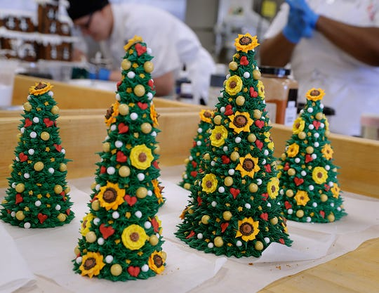 Marissa Varela puts hours into colorful edible trees for  a gingerbread replica of her parents' house.