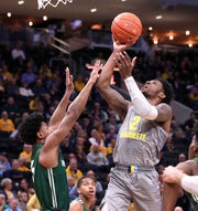 Marquette guard Sacar Anim scores on a drive against Jacksonville on Wednesday night.