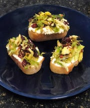 Brussels Sprout, Cranberry and Ricotta Crostini is a festive appetizer.