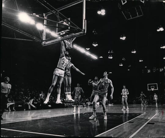 Kareem Abdul-Jabbar of the Milwaukee Bucks sank a layup and was fouled in the process in 1973.