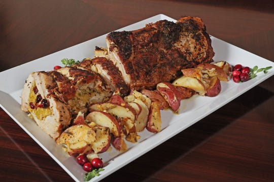 Roasted Stuffed Loin of Pork can be served with sweet potatoes or red-skinned potatoes.