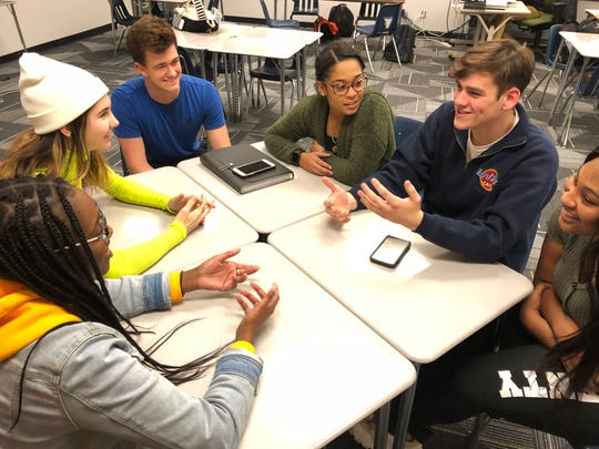 Students at Wauwatosa West High School discuss how to gain traction around their idea of walking out of school on Dec. 13 to bring awareness to gun violence in schools.