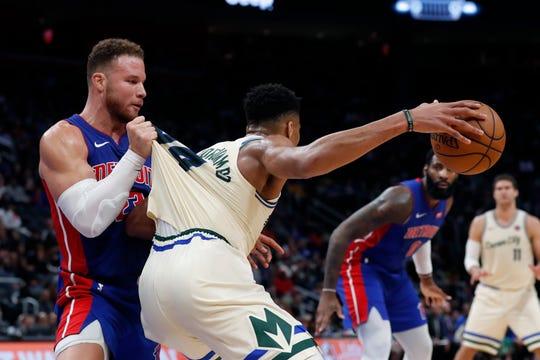 Pistons forward Blake Griffin pulls on Bucks forward Giannis Antetokounmpo's jersey Wednesday night.