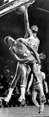 Kareem Abdul-Jabbar dunks the ball over Portland's Ollie Johnson in November of 1973.