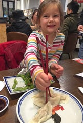 Mara Sherwood tucks into dumplings and edamame during a girls night out in China.