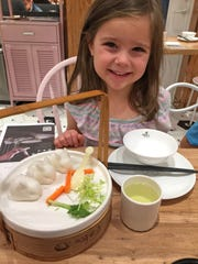 Mara Sherwood, 6, was delighted by bunny-shaped coconut puddings.