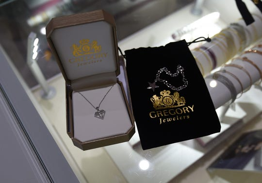 This diamond pendant necklace and charm bracelet, provided by Gregory Jewelers, will be awarded to participants in the inaugural Santa's Diamond Dash footrace tonight.