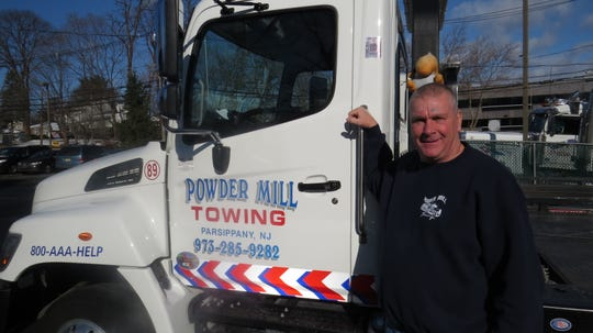 Mike Benson, 57, of Morristown, and owner of Powder Mill Towing in Parsippany, was honored for his acts of heroism with the 2019 Real Heroes of the Road award from AAA and Ford. December 5, 2019.