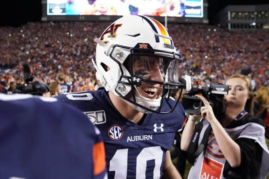 Auburn quarterback Bo Nix (10) celebrates the win over the Alabama in the Iron Bowl at Jordan-Hare Stadium on Nov. 30, 2019.