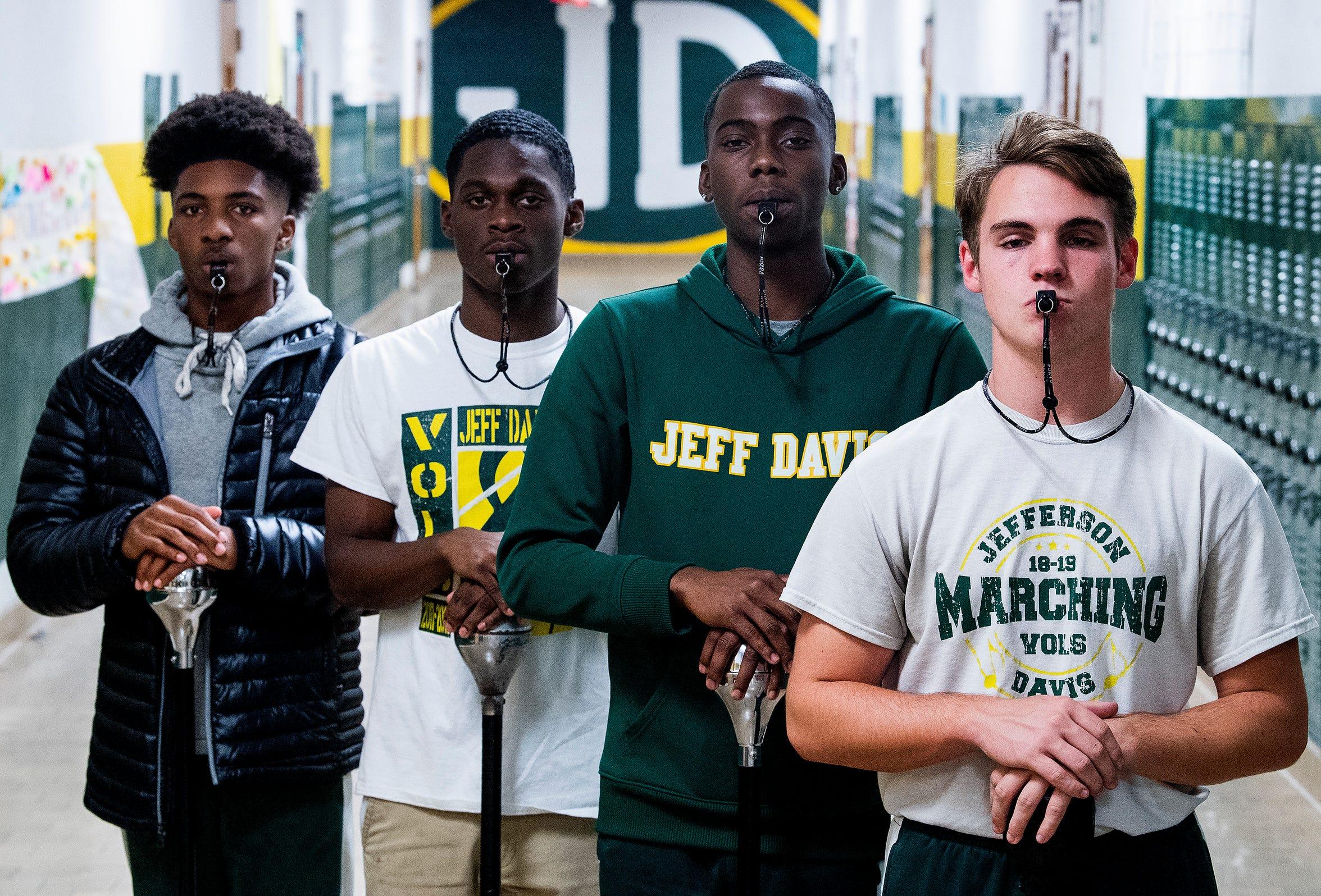 Jeff Davis Marching Band Drum Majors, from left, Jalen Jones, Dominic Williams, Xavier Jackson and Justin Heideman pose at the school in Montgomery, Ala., on Wednesday December 4, 2019.
