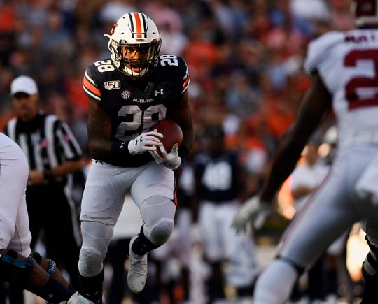 Auburn running back JaTarvious Whitlow (28) runs the ball against Alabama in the Iron Bowl on Saturday, Nov. 30, 2019 in Auburn, Ala.