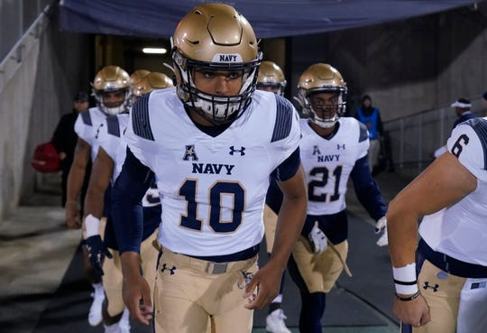 Navy quarterback Malcolm Perry (10) and his teammates take the field before the start of the game against the Connecticut on Nov. 1.