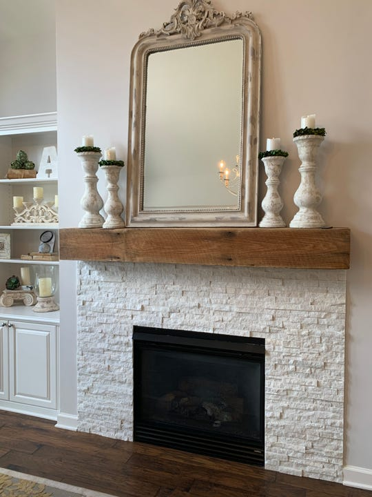 Sara Affonso used barnwood to give her fireplace a rustic look.