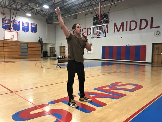 Cuban-American author Pablo Cartaya delivers a spirited speech to Freedom Middle School students about the beauty of embracing one's heritage.