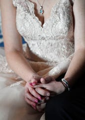 Amanda DiMarzio, and  Sean Woodard hold hands before their wedding Wednesday, Dec. 4, 2019, in Nashville, Tenn. A not-for-profit, Wish Upon a Wedding, put on the ceremony and reception at little cost to the bride and groom.