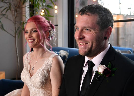 Amanda DiMarzio, who's is battling a rare form of cancer, and Sean Woodard laugh at a reporter's question before their wedding. Wednesday, Dec. 4, 2019, in Nashville, Tenn.