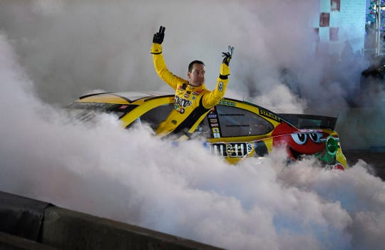 Kyle Busch waves during the NASCAR Burnouts on Broadway event on Wednesday.